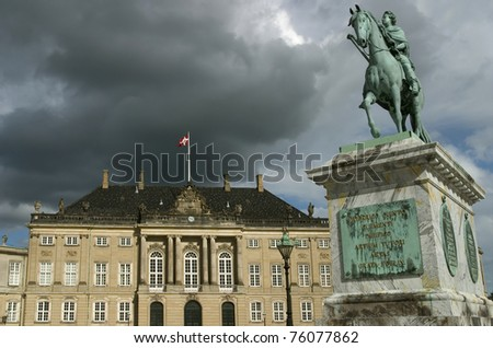 Amalienborg, the Royal Palace. Copenhagen, Denmark.  The Equestrian statue is of  King Frederik V, - stock photo