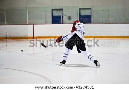 Amateur ice hockey players in a hockey arena - stock photo