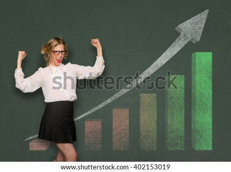 Amateur investor business woman celebrates investment earnings chart rising bar graph chalkboard blackboard