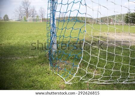 amateur Net soccer goal football green grass - stock photo