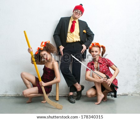 Amateurs man and women in bizarre games - stock photo
