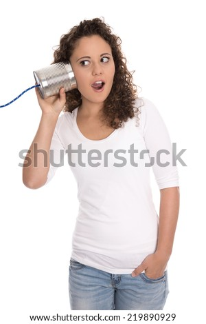 Amazed and stunned isolated girl listening to tin can. Business communication concept. - stock photo