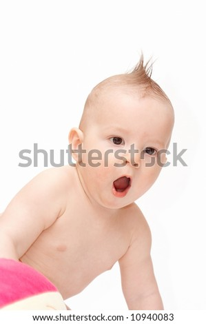 amazed baby with spiky hair - stock photo