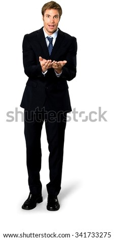 Amazed Caucasian man with short medium blond hair in business formal outfit holding invisible object - Isolated