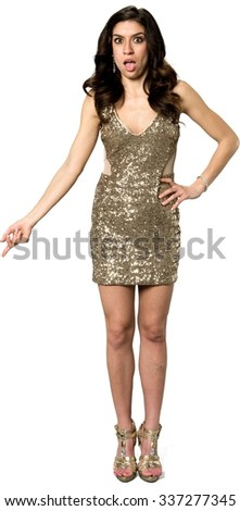 Amazed Caucasian young woman with long dark brown hair in evening outfit with hands on hips - Isolated