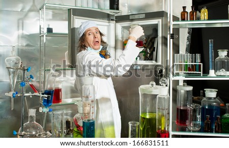 Amazed chemist in a laboratory - stock photo