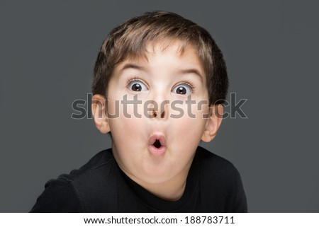 Amazed child with great expression - stock photo