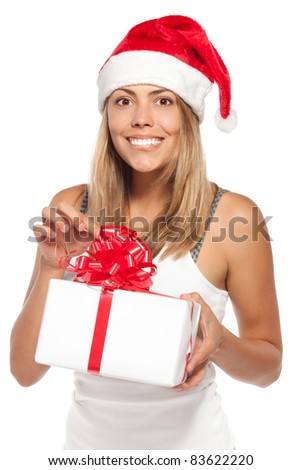 Amazed female in Santa Claus hat holding gift box, over a white background. - stock photo