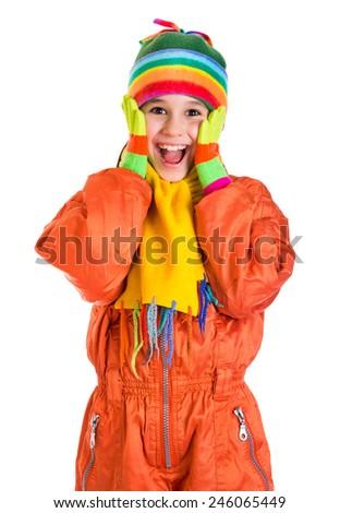 Amazed girl in orange winter sports overalls, isolated on white - stock photo