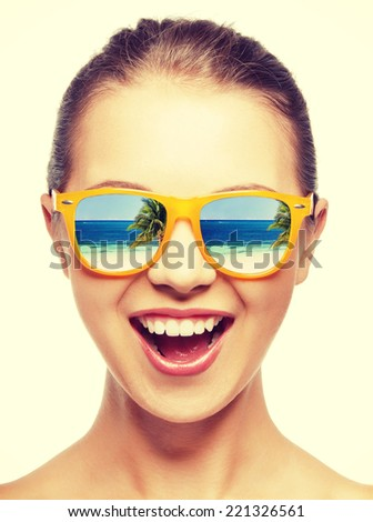 amazed girl in shades with beach reflection - stock photo