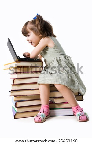 Amazed girl of preschool age sitting in front of laptop and looking into its display with open mouth - stock photo