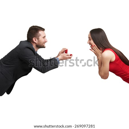 amazed happy woman looking at ring and happy man looking at her. isolated on white background - stock photo