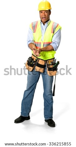 Amazed Male Construction Worker with short black hair in uniform hurt his hand - Isolated - stock photo