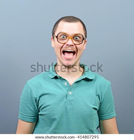 Amazed man having reaction about something  - stock photo