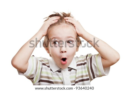 Amazed or surprised child boy hand holding hairs on head - stock photo