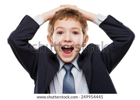 Amazed or surprised child boy in business suit hand holding hairs on head white isolated - stock photo