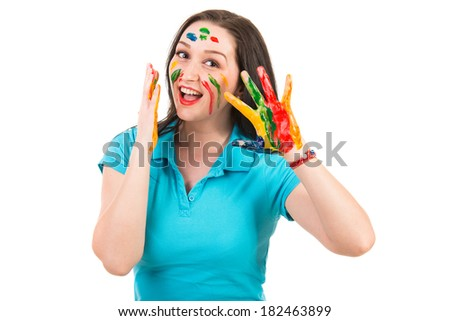 Amazed woman with paints on face and hands isolated on white background - stock photo