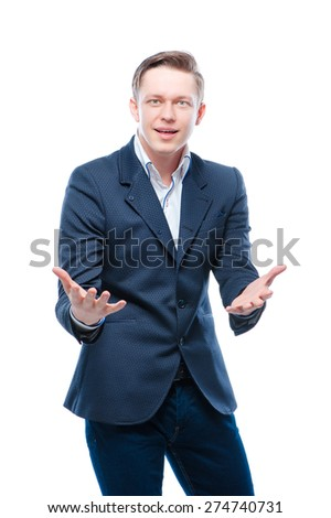 Amazed young businessman gesturing looking at camera. Isolated on white. - stock photo
