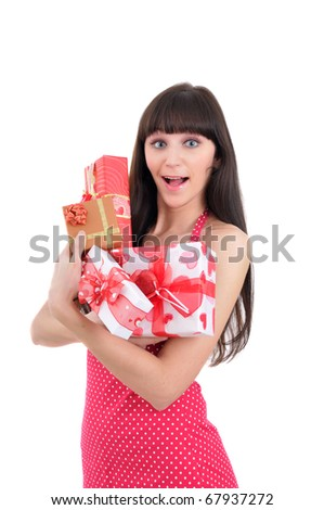 amazed young girl with heaps of present isolated on white