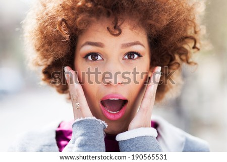 Amazed young woman - stock photo