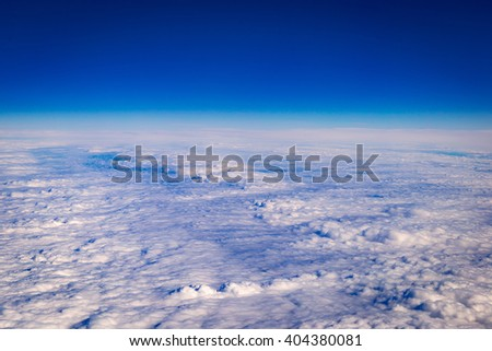 Amazing Aerial View of Clouds - Panoramic Birds Eye View of White Clouds and Blue Sky - stock photo