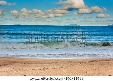 Amazing beach with a beautiful sky - stock photo