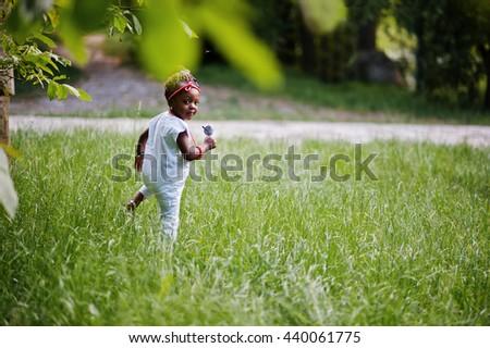 Amazing beautiful african american baby girl with sunglasses having fun - stock photo