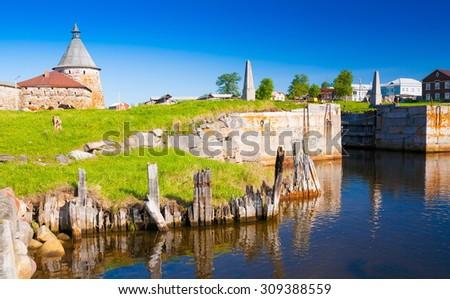 Amazing beautiful landscape. Old historical orthodox unique dome church monastery. Island Solovki. north country Russia. White sea. Sunny Day. Blue lake water. UNESCO world heritage.  - stock photo