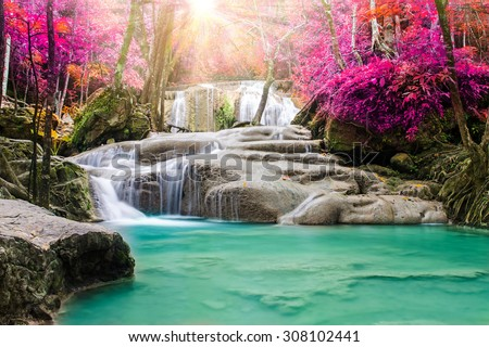 Amazing beautiful waterfall in autumn forest  - stock photo