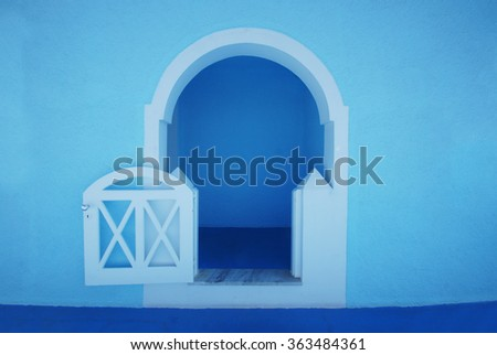 Amazing blue arch on Santorini island. - stock photo