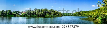 Amazing blue lake  and sky with clouds. - stock photo