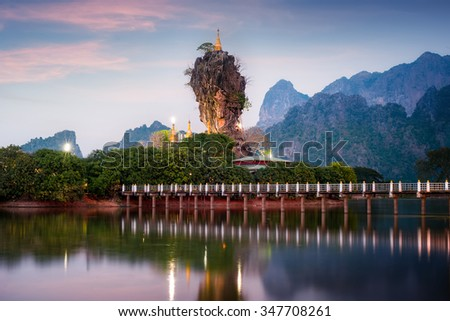 Amazing Buddhist Kyauk Kalap Pagoda under evening sky. Hpa-An, Myanmar (Burma) travel landscapes and destinations
