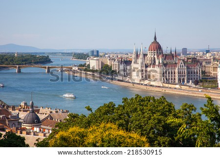 amazing building of Parliament in Budapest and ships in front of it - stock photo