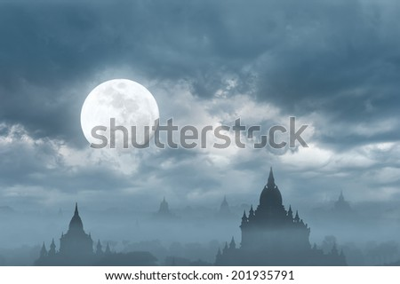 Amazing castle silhouette under moon at mysterious night. Fantasy  background in vintage style with old Buddhist Temples Sulamani and Tha Beik Hmauk Gu Hpaya at Bagan Kingdom, Myanmar (Burma) - stock photo