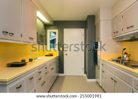 Amazing classic white yellow kitchen. - stock photo
