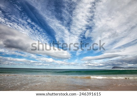 Amazing cloud formations and waves, Bruny Island, Tasmania - stock photo