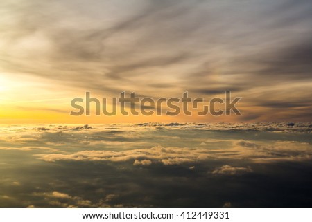Amazing clouds landscape. The view from the eye of birds. Landscape over the clouds and the sunrise - stock photo
