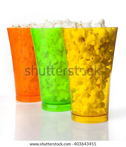 Amazing colored glasses of popcorn isolated on a white background - stock photo