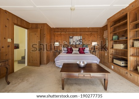 Amazing Craftsman bedroom with crafts style furnishings and wooden shelf  - stock photo