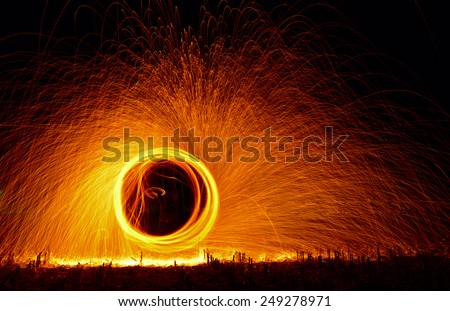Amazing fire show at night - stock photo