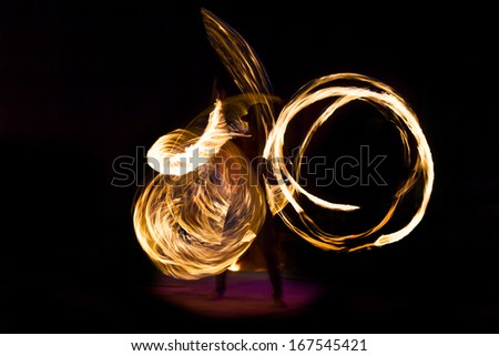 Amazing Fire Show at night on Phi Phi Island, Thailand - stock photo