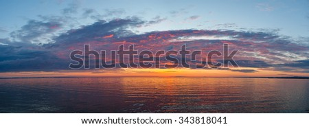 Amazing gold orange sky and water at sunset over Baltic sea, Tallinn, Estonia - stock photo