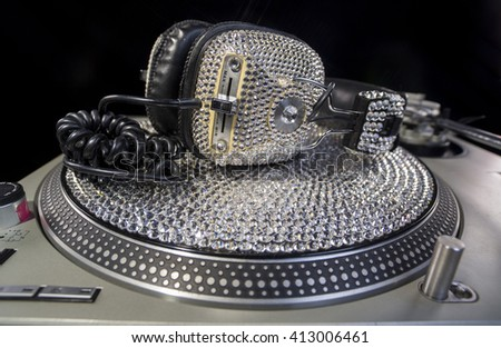 amazing handmade bling crystal covered headphones on a crystal record and turntable