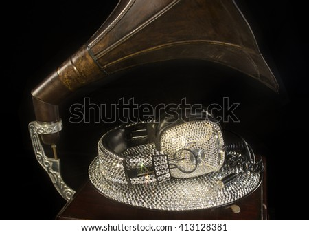 amazing handmade bling crystal covered headphones on a crystal record and vintage gramophone - stock photo