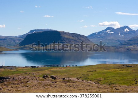 Amazing Icelandic landscape with a mountains and a gulf called Hvalfjordur. - stock photo