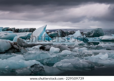 Amazing Jokulsarlon glacial lake full of melting icebergs. - stock photo