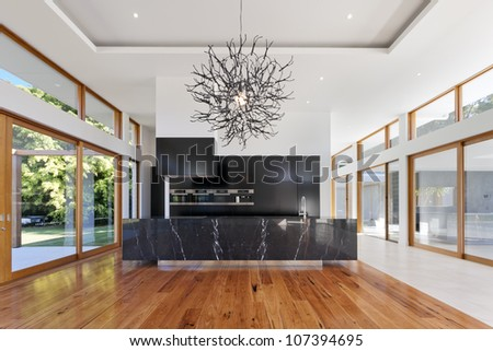 Amazing kitchen and living area in new spacious mansion - stock photo