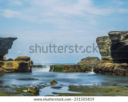 Amazing landscape at The Tanah Lot Temple, the most important indu temple of Bali, Indonesia. - stock photo