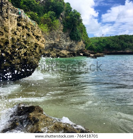 Amazing landscape of greens, rocks and ocean waves of the Bali shores