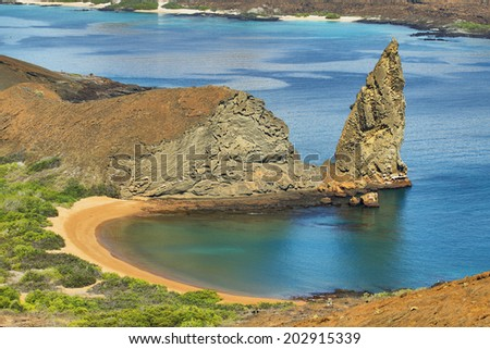 Amazing landscape of pinnacle Rock and surroundings in Bartolome island, Galapagos, Ecuador - stock photo